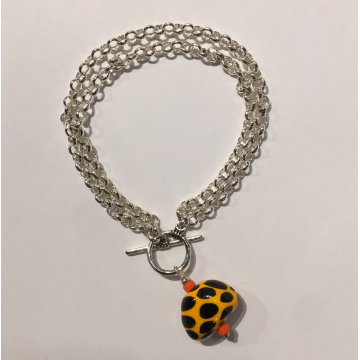 "Sherie Presta, Toggle bracelet, Handmade ceramic bead w 8x silver-plated chain/w, Bead is 1"" in Diameter."